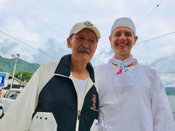 Sergiu Kondanna standing with an old man